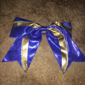 Blue and gold cheer bow